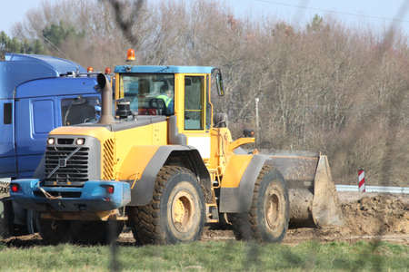 skid steer loader: tractor in construction site