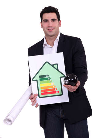 Man with energy rating sign  and piggy bank photo