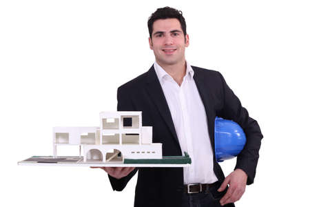 Architect holding replica model of building photo