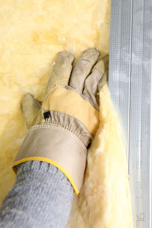 insulating: Worker installing insulation
