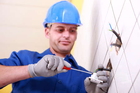 Electrician using screwdriver photo