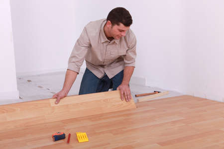 Man installing laminate flooring photo