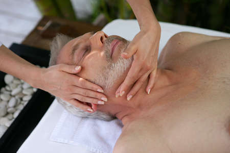 massaged: Senior man having a massage