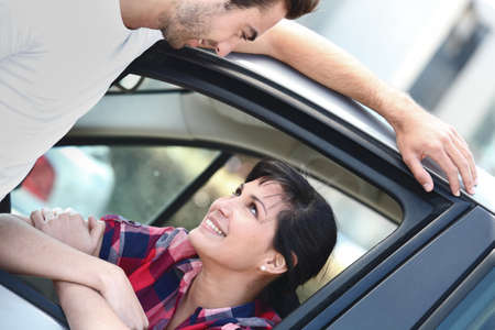 drive through: Couple talking through a car window