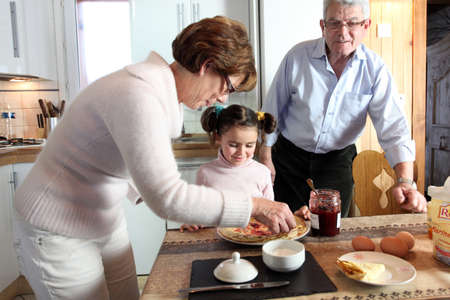 Couple with their grandchild at breakfast Stock Photo - 22080714