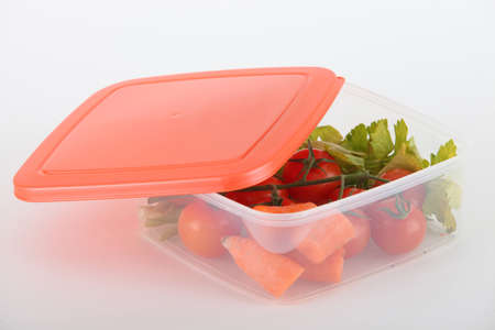 Raw vegetables in a plastic container photo