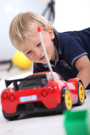 controlled: Boy with radio controlled car Stock Photo
