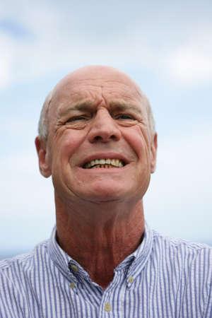 anguished: Senior man in discomfort Stock Photo