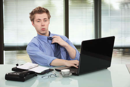 workaholic: Office worker getting tired Stock Photo