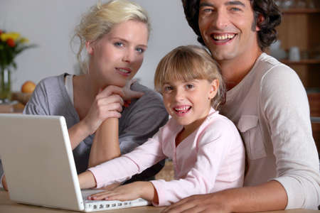 initiating: parents initiating little girl to computer