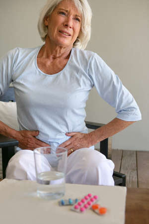 Senior woman suffering from stomach ache