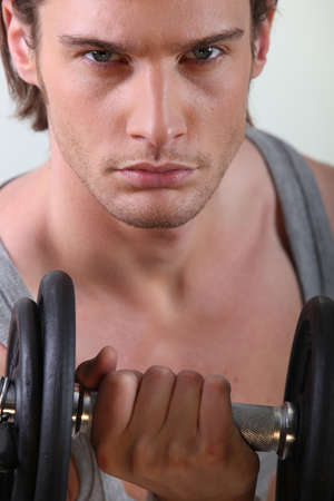 close shot of handsome young man lifting weight Stock Photo - 22080791