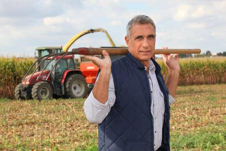prongs: Farmer carrying a pitchfork