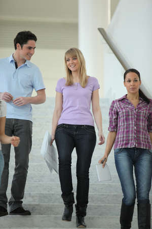 parsimony: young people going down the stairs Stock Photo