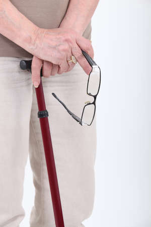 walking stick: Old person with walking stick