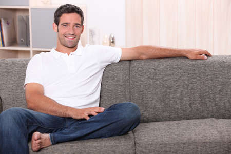 portrait of a man on a couch photo