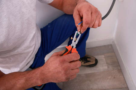 qualified worker: electrician Stock Photo