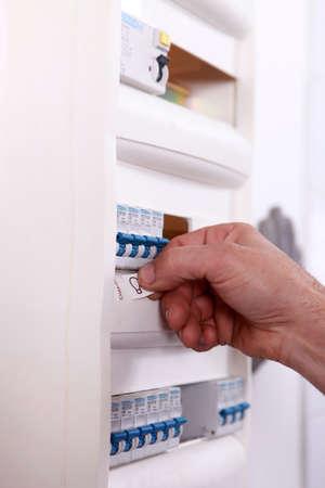 breaker: Electrician labeling fuse box