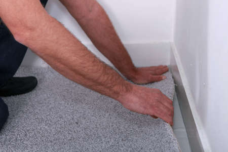 carpet flooring: Man putting in carpet
