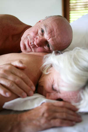 Senior couple in bed Stock Photo - 22200195