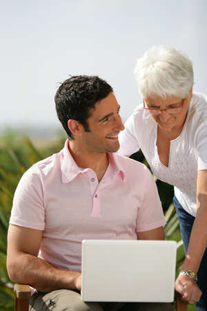Wi Fi: Man and senior woman with a laptop