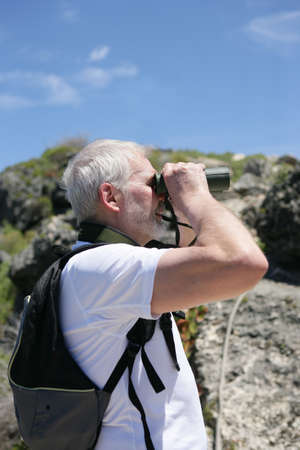 Man with binoculars photo
