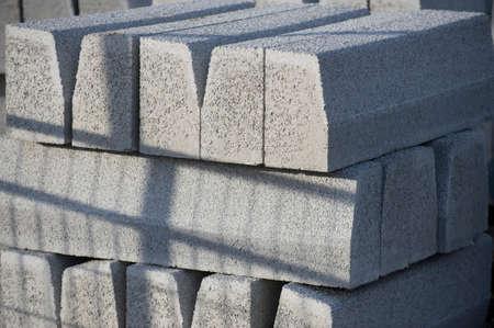 kerb: Grey concrete blocks