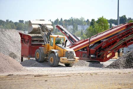 transferring: Digger transferring quarried materials