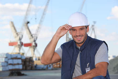 foremaster: craftsman on a construction site smiling