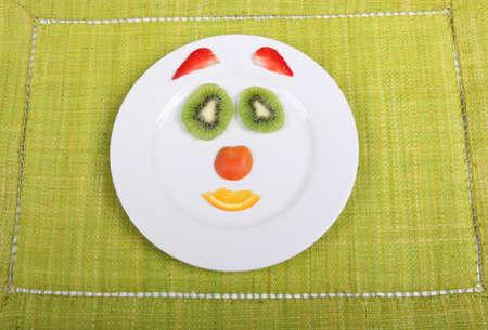 Sliced fruit arranged into a face shape