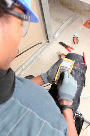 elevation meter: electrician taking measurements