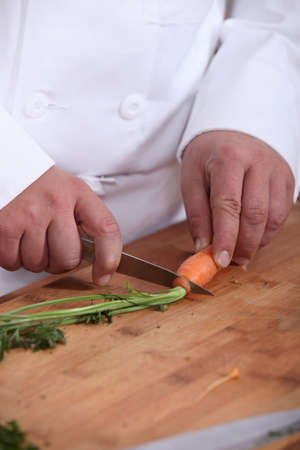 Man cutting carrots photo