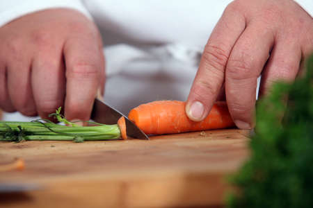 blanch: Close-up of chef slicing carrot