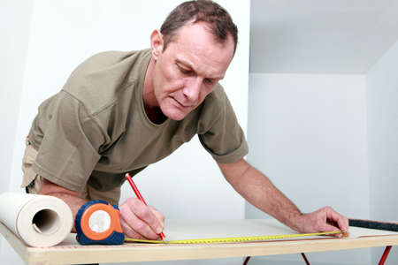 Man measuring wallpaper photo