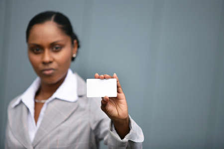 Businesswoman with a blank card Stock Photo - 22256038