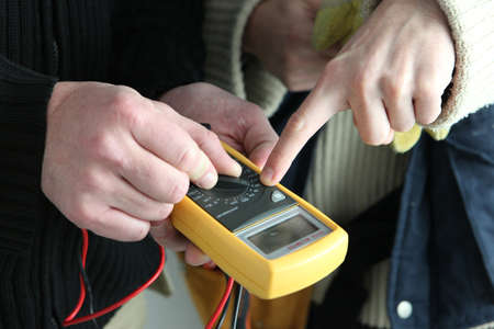 ammeter: electricians using tester Stock Photo