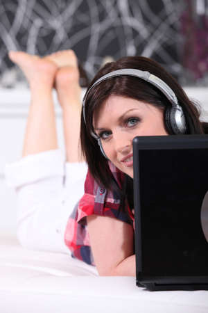 Woman with a laptop and headphones photo