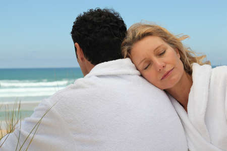bath robes: Husband and wife on the beach in bath robes Stock Photo