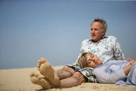 union beach: Married couple sat on a beach