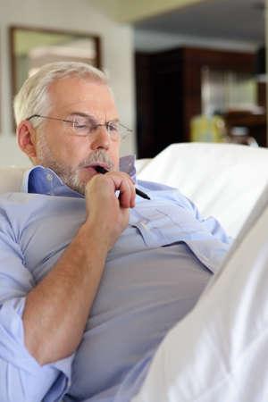 sudoku: Senior man doing crossword puzzles