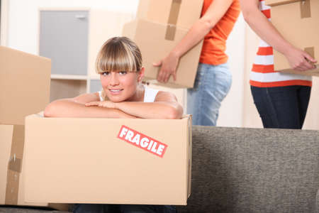 Young woman moving home photo