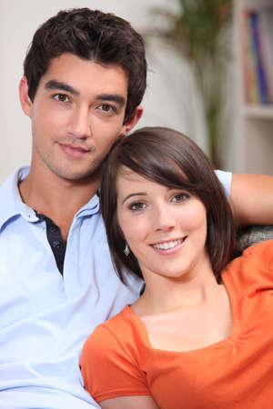 easy going: Young couple sitting in their front room Stock Photo