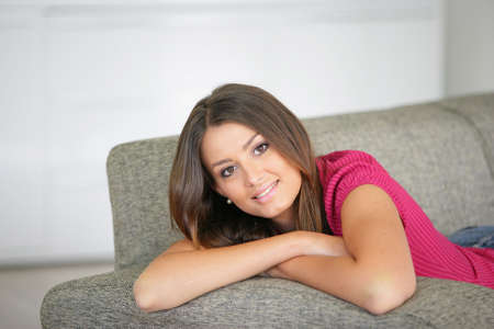 Woman relaxing on her sofa photo