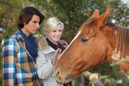 Couple with a horse Stock Photo - 22256373
