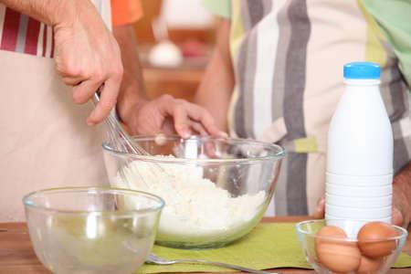 stiring: Two men baking together Stock Photo