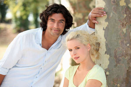 blonde haired: Young couple walking Stock Photo