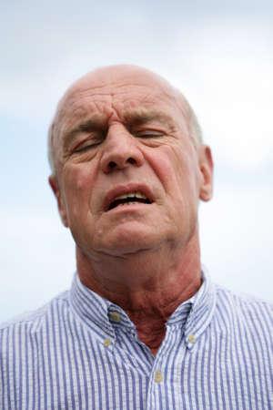 55 60 years: Annoyed old man Stock Photo
