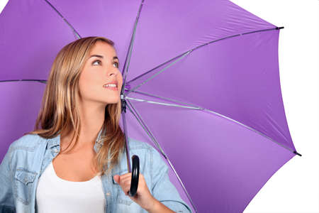 Blond woman with purple umbrella open photo