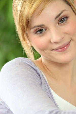 Portrait of a friendly casual young woman Stock Photo - 22255899