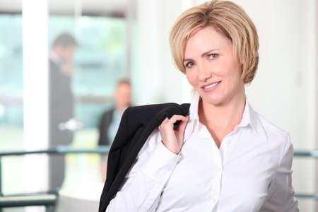 blazer: Businesswoman carrying her jacket over her shoulder